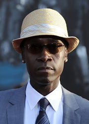 Don paired his sleek suit with a cool straw hat.