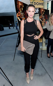 Laura rocked a lace-inset jumpsuit with lace-up ankle booties.