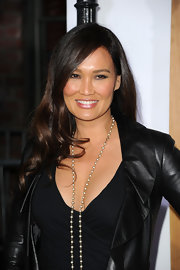 Tia Carrere wore a dramatic curly 'do at the premiere of 'No Strings Attached.'