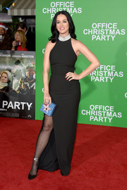 Katy Perry cut a classic silhouette in a black Cinq à Sept halter gown with a high slit and a pearl-embellished neckline during the premiere of 'Office Christmas Party.'