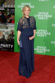 Molly Sims glammed up her baby bump in a navy gown with a sheer, beaded bodice and flutter sleeves for the premiere of 'Office Christmas Party.'