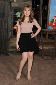 Jeanette McCurdy paired her blush blouse with a high-waisted mini skirt.