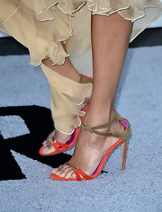 To combat a solid colored gown, Zoe added some pops of color to her look with these multi-colored sandals.
