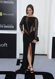 This sheer black dress that features a thigh-high front slit and sequined panels looked simply stunning on Ashely Williams.