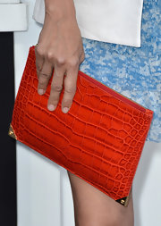 Catherine Bell's orange oversized zip clutch added a touch of unexpected color on the red carpet.