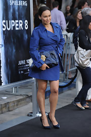 Tia Carrere showed off her style chops with this trenchcoat and oversized leather clutch combo at the 'Super 8' premiere.