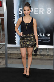 Jessica Parker Kennedy wore a black mini skirt with metallic gold lace overlay at the premiere of 'Super 8.'