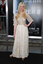 Elle Fanning teamed her romantic vintage gown with '70s inspired nude patent platforms with wooden wedges at the 'Super 8' premiere.
