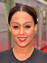 Tia Mowry injected a jolt of color via some bright red lipstick.