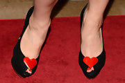 Holly Madison's black peep toes looked fun and flirty with a heart detail.