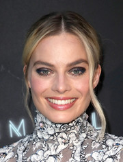 Margot Robbie looked romantic wearing this center-parted chignon at the premiere of 'Terminal.'
