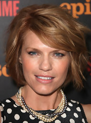 Kathleen Rose Perkins'  elegantly entwined pearl necklace was a ladylike, glamorous choice.