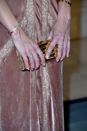 Katie Holmes added more sparkle with different styles of diamond rings.