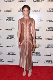 Katie Holmes polished off her look with strappy nude sandals by Tamara Mellon.
