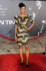 Yaya accessorized her graphic green cocktail dress with black peep-toe pumps.