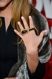 Cassie Scerbo showed her edgier side with a gold and black knuckle ring at the '21 and Over' premiere.