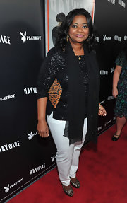 Octavia Spencer added an exotic element to her look with a leopard print clutch.