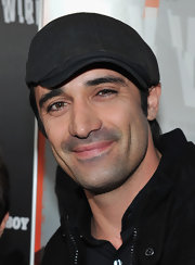 Gilles Marini covered up his dreamy 'do with a black newsboy cap for a premiere in LA.