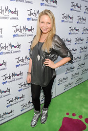 Alli Simpson paired her shiny look with a matte finish silver pendent.