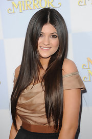 Kylie Jenner wore her hair in shiny ultra-long layers while attending the premiere of 'Mirror Mirror.'