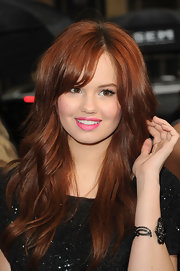 Debby Ryan swept on a pretty hot pink shade of lipstick for the world premiere of 'Mirror Mirror.'