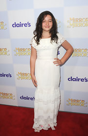 Amara Miller chose to wear this lacy white maxi-dress on the red carpet of the 'Mirror Mirror' premiere.