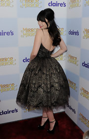 Lily Collins attended the world premiere of 'Mirror Mirror' wearing a pair of black peep toe pumps with ankle straps.