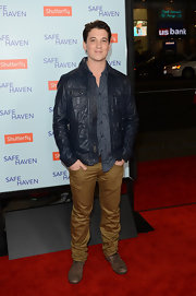 Miles Teller gave his preppy look a bit of an edge with this navy bomber jacket.