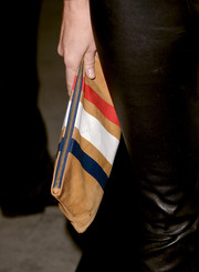 Rebecca Romijn accessorized with a colorful suede clutch when she attended the 'Thanks for Sharing' premiere.
