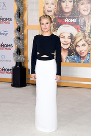 Kristen Bell went sleek and modern in a black-and-white cutout column dress by Michael Kors at the premiere of 'A Bad Moms Christmas.'