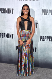 Annie Ilonzeh stole the spotlight at the 'Peppermint' premiere in a Rami Kadi gown that featured a rainbow-sequined skirt and a braided leather bodice with a sexy cutout.