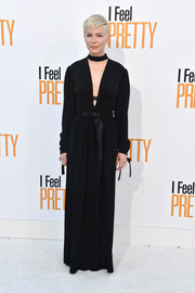 Michelle Williams went goth in a black Louis Vuitton maxi dress with a plunging neckline and choker detail for the premiere of 'I Feel Pretty.'