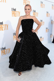 Busy Philipps complemented her dress with an embellished box clutch by Edie Parker.
