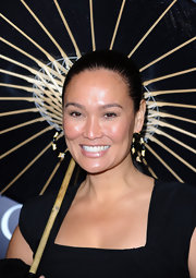Tia Carrere accessorized with a pair of gold and black costume hoops at the premiere of 'Legion.'