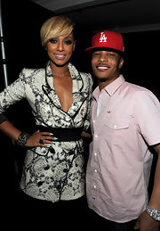 T.I. paired his button up shirt with an L.A. Dodgers hat.