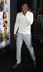 Sean Combs teamed gray leather slip-on shoes with a white sweater and light blue slacks for the premiere of 'Think Like a Man.'