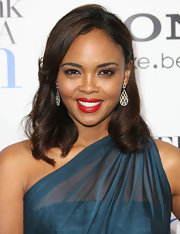 Sharon Leal attended the premiere of 'Think Like a Man' wearing a vibrant shade of orange-red lipstick with hint of shine.