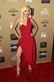 Lady Gaga complemented her gown with red platform sandals by Brian Atwood.