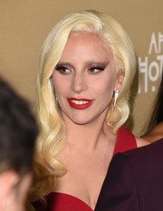 Lady Gaga matched her edgy eye makeup with an equally striking red lip.