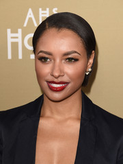 Kat Graham attended the premiere of 'American Horror Story: Hotel' rocking a slicked-down, side-parted 'do.