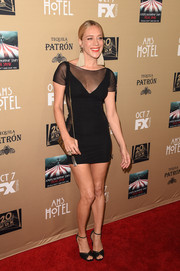 Chloe Sevigny complemented her dress with black ankle-strap peep-toes.