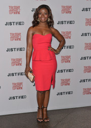 Erica Tazel sealed off her look with an elegant  ivory folded-satin clutch.