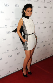 Emmanuelle Chriqui accented her black and white mini dress with black satin platform pumps.