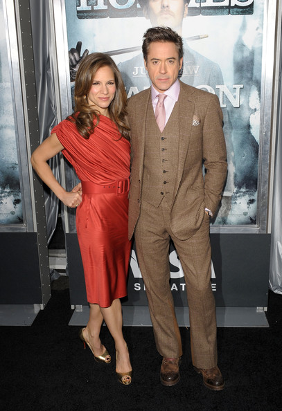 Gold Christian Louboutin peep-toes completed Susan Downey's chic look.