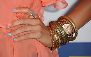Romi rocked an arm full of bangle bracelets in gold which she paired with a matching time piece.