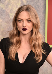 For her beauty look, Amanda Seyfried went goth with dark red lipstick.