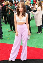 Kelli Berglund paired her sexy top with on-trend lavender wide-leg pants by House of CB.