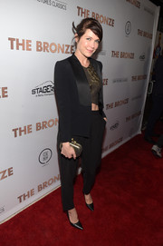 Katie Aselton opted for an androgynous vibe with this black tux and crop-top combo at the premiere of 'The Bronze.'