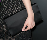 Greta Gerwig paired a black satin clutch with her LBD for a totally elegant look during the 'Damsels in Distress' premiere.