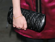 Amanda Seyfried showed off her quilted leather clutch while hitting the premiere of 'Mother and Child'.